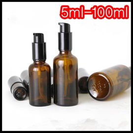 China Brown Color Essential Oil Glass Dropper Bottle Black Pump For Cosmetic Lotion supplier
